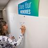Joseph Weiser | The Goshen News<br /> Goshen Hospital RN Katrina Rexters of Goshen writes a memory on the wall of the original hospital on Monday.