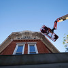 Joseph Weiser   The Goshen News<br /> Signtech employee Tod Lehman of Goshen installs the first set of 10,000 new led Christmas lights on the roof of L&M Hair Design to replace the lights damaged by a major hail storm back in June on Monday.