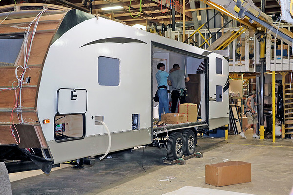 John Kline | The Goshen News<br /> Employees at Keystone RV's Plant 31 in Goshen, Indiana, work to complete a travel trailer in this August 2019 file photo. The RV industry is being watched by economists because of its history of being a bellweather for the nation's economy.