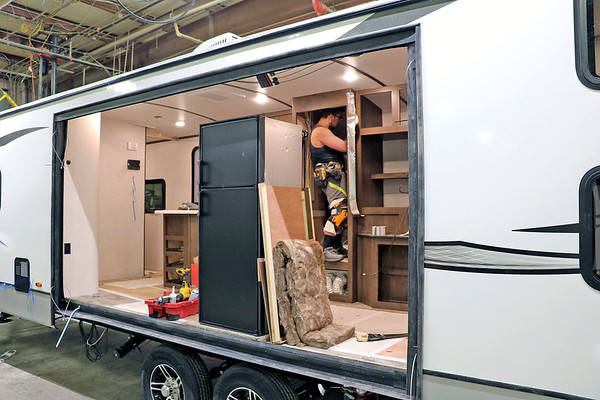 John Kline | The Goshen News<br /> A worker at the Keystone RV Plant 31 in Goshen, Indiana works to construct a recreational vehicle in this August 2019 file photo. The RV industry is often considered a bellweather for the nation's economy.