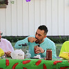 AIMEE AMBROSE | THE GOSHEN NEWS <br /> Goshen Mayor Jeremy Stutsman (center) tastes salsa while he, food columnist Marshall King (left) and local business owner Tony DeMarco (right) serve as judges during the fourth annual Salsa Festival at Goshen Farmers Market, 212 W. Washington St., Saturday.