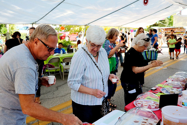 AIMEE AMBROSE | THE GOSHEN NEWS <br /> Attendees sample salsas from local restaurants during the fourth annual Salsa Festival at Goshen Farmers Market, 212 W. Washington St., Saturday.