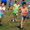 Roger Schneider | The Goshen News<br /> Concord Ox Bow Elementary School second-graders Brylee Jimenez and Kenneth Savillon race during the school's Jog-A-Thon Friday. Students in all grades solicited pledges for the number of laps they ran during the hour-long event for each grade level. Money raised will be used to help the parent-teacher organization.