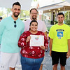 AIMEE AMBROSE | THE GOSHEN NEWS <br /> Rut Wisser, Goshen,stands with salsa judges Mayor Jeremy Stutsman, food columnist Marshall King and local business owner Tony DeMarco at the end of the fourth annual Salsa Festival at Goshen Farmers Market, 212 W. Washington St., Saturday. Wisser's salsa won Best of the Best of the salsas that were judged this year.