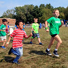 Roger Schneider | The Goshen News<br /> Rigoberto Salaeron-Berrios, left, a second-grader at Concord Ox Bow Elementary School, puts on a burst of speed during the school's Jog-A-Thon Friday. Students in all grades spent an hour running and walking around a course to collect on pledges they solicited for the number of laps they completed. The money raised will be used to fund the school's parent-teacher organization's projects.
