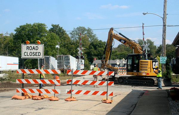 JOHN KLINE   THE GOSHEN NEWS<br /> Construction work on Phase 3 of the city's Ninth Street Multi-Use Path project begins at the intersection of Ninth and Jackson streets Friday afternoon.