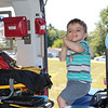 AIMEE AMBROSE | THE GOSHEN NEWS <br /> Emmett Jankowski, 2, Elkhart, sits inside the MedFlight emergency helicopter from Memorial Hospital of South Bend while enjoying Touch a Truck at Faith United Methodist Church along C.R. 18 Saturday. The event let children climb into and explore a vareity of vehicles, including fire trucks, police vehicles, construction equipment, tow trucks and public service trucks, as well as MedFlight.