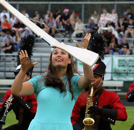 Roger Schneider   The Goshen News<br /> NorthWood color guard member Paige Blosser prepares to catch her twirling rifle Saturday during the band's performance at the Concord invitational. More photos from the event are on A7 and at goshennews.com.