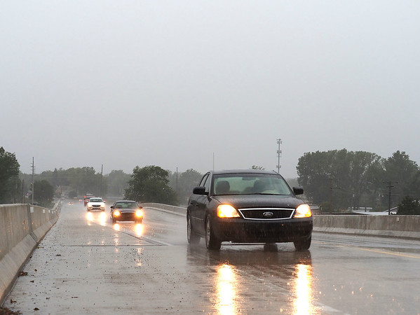 Joseph Weiser   The Goshen News<br /> A view of cars passing through the rain on the U.S. 33 overpass during the thunderstorm coming through Goshen, IN on Friday, September 27, 2019.