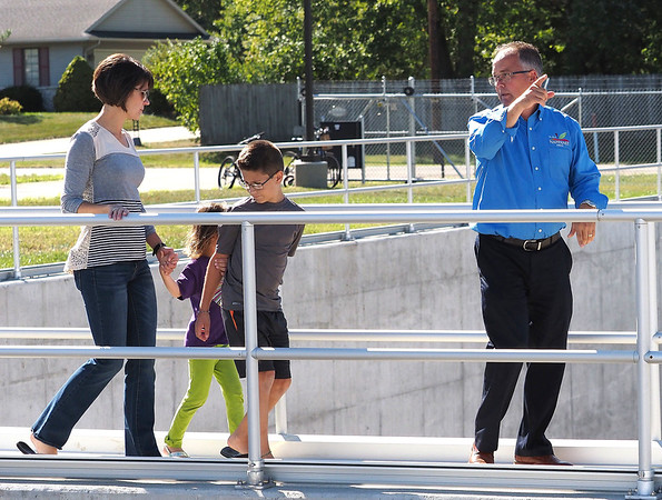 Joseph Weiser   The Goshen News<br /> Nappanee Mayor Phil Jenkins gives a tour of the Nappanee sewer overflow plant to Mary Dale, Brayden Dale, and Madison Dale on Thursday, September 26, 2019 at the Nappanee Waste Treatment Plant in Nappanee, IN.