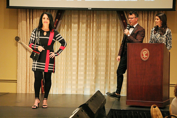 AIMEE AMBROSE   THE GOSHEN NEWS <br /> Toni Bailey, Elkhart, models an outfit as the hosts introduce her story during the 2019 Fashion Show, which served as fundraiser for Cancer Resources for Elkhart County at the Lerner Theatre in Elkhart Wednesday.