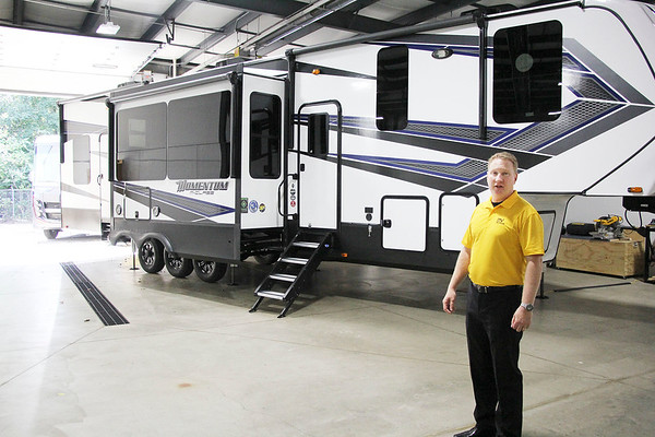 AIMEE AMBROSE   THE GOSHEN NEWS <br /> Curtis Hemmeler, executive director of the new RV Technical Institute, stands before a camper in the bay area of the new facility along Middlebury Street in Elkhart. <br /> The center opened Monday with a focus on providing training for recreational vehicle service technicians.