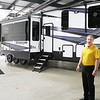 AIMEE AMBROSE | THE GOSHEN NEWS <br /> Curtis Hemmeler, executive director of the new RV Technical Institute, stands before a camper in the bay area of the new facility along Middlebury Street in Elkhart. <br /> The center opened Monday with a focus on providing training for recreational vehicle service technicians.