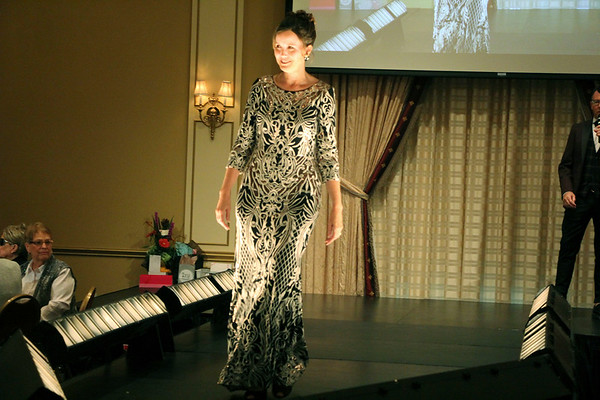 AIMEE AMBROSE   THE GOSHEN NEWS <br /> Roxanne Markham shows off a dress during the 2019 Fashion Show, which served as a fundraiser for Cancer Resources for Elkhart County at the Lerner Theatre in Elkhart Wednesday.