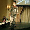 AIMEE AMBROSE | THE GOSHEN NEWS <br /> Roxanne Markham shows off a dress during the 2019 Fashion Show, which served as a fundraiser for Cancer Resources for Elkhart County at the Lerner Theatre in Elkhart Wednesday.