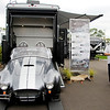 AIMEE AMBROSE | THE GOSHEN NEWS <br /> A Shelby Cobra is on display, parked on a race ramp attached to the rear of a Heartland Cyclone toy hauler at Thor Motor Coach's exhibit area during the 2019 RV Open House at the RV/MH Hall of Fame in Elkhart Tuesday.