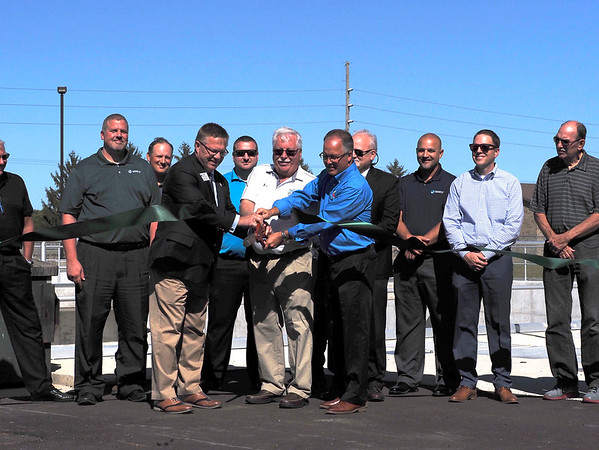 Joseph Weiser   The Goshen News<br /> Nappanee Utilites Manager Gale Gerber and Nappanee Mayor Phil Jenkins cut the ribbon to open the Nappanee sewer overflow plant on Thursday, September 26, 2019 at the Nappanee Waste Treatment Plant in Nappanee, IN.