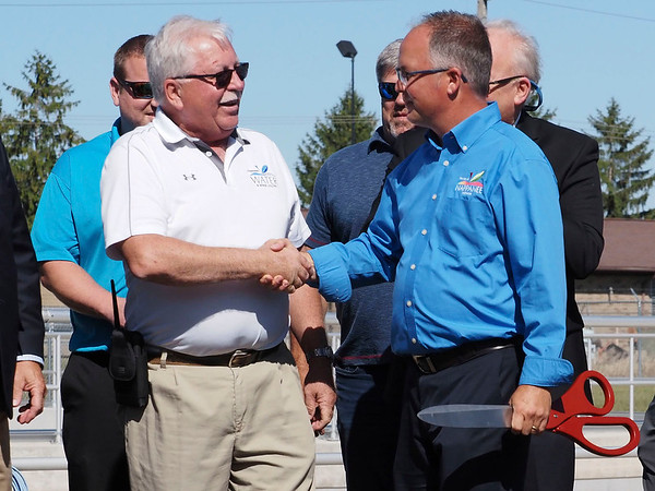 Joseph Weiser | The Goshen News<br /> Nappanee Utilites Manager Gale Gerber and Nappanee Mayor Phil Jenkins cut the ribbon to open the Nappanee sewer overflow plant on Thursday, September 26, 2019 at the Nappanee Waste Treatment Plant in Nappanee, IN.