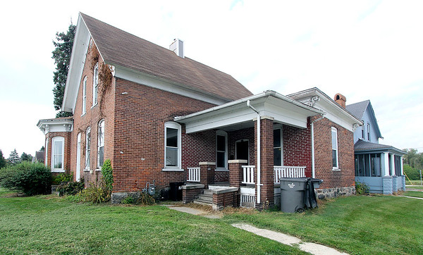 ROGHER SCHNEIDER | THE GOSHEN NEWS<br /> Goshen Redevelopment Commission members are currently reviewing a proposal for the purchase of this historic brick home, located at 401 S. Third St., and a connected property at 204 W. Madison St., after pulling back on a plan to demolish the connected properties.