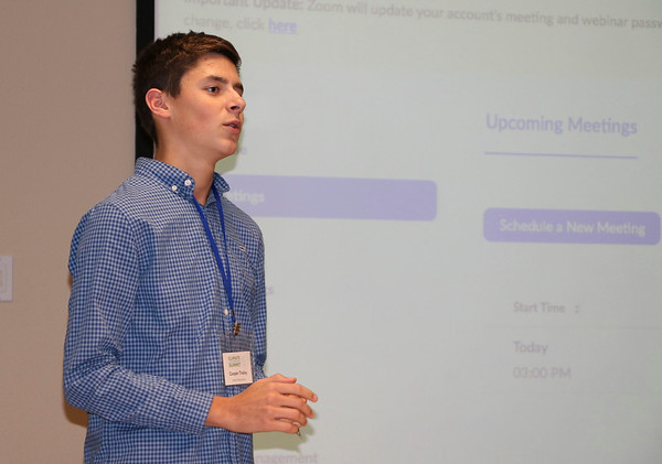 """JOHN KLINE   THE GOSHEN NEWS<br /> High school sophomore and budding environmental activist Cooper Tinsley leads a special """"Youth Empowered"""" workshop during the fourth annual Indiana Climate Leadership Summit at Goshen College Thursday afternoon."""