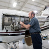 Goshen Municipal Airport Chief Inspector Terry Chupp performs maintenance on a Cessna Citation Encore jet Wednesday afternoon at the Goshen Municipal Airport maintenance hangar.