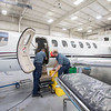 Goshen Municipal Airport Apprentice Mechanic Jim Bradbury, left, and Chief Inspector Terry Chupp perform maintenance on a Cessna Citation Encore jet Wednesday afternoon at the Goshen Municipal Airport maintenance hangar.