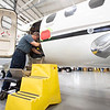 Goshen Municipal Airport Apprentice Mechanic Jim Bradbury performs maintenance on a Cessna Citation Encore jet Wednesday afternoon at the Goshen Municipal Airport maintenance hanger.