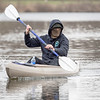 Kirk Bottorff, of Goshen, paddles back to shore after kayaking the Elkhart River Tuesday afternoon near the Goshen Dam.