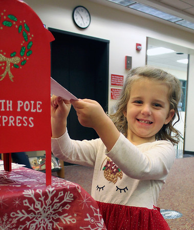 Leona Everage, 4, who attends Brenneman pre-school, slips her letter to Santa into a mailbox at the Goshen Public Library. She is the daughter of Austin and Brittany Everage of Goshen.