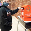 Saxon Smith, son of Emma Estep and Jack Salazar drops his letter into Santa's mailbox at Prairie View Elementary School. Saxon attends Prairie View Elementary.