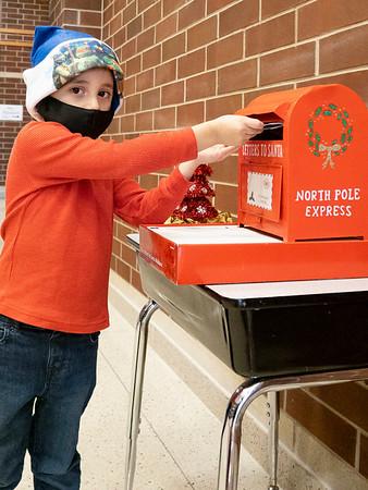 Jayden Hernandez, son of Mitizi and Brian Hernandez drops his letter into Santa's mailbox at Prairie View Elementary School. Jayden attends Prairie View Elementary.