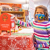 Ava Yoder, 5, daughter of Seth and Sarah Yoder, drops her letter into Santa's mailbox at the Goshen Public Library. He attends Brenneman Daycare Ministry.