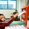 Eli Galindo, 2, son of Diana Hernandez, drops his letter into Santa's mailbox at the Goshen Public Library. Eli attends Walnut Hill Early Childhood.