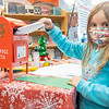 Brooklyn Leaman, 6, daughter of Jared and Addie Leaman, drops her letter into Santa's mailbox at the Goshen Public Library. Brooklyn attends Model Elementary.