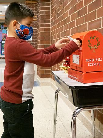 Noah Cerecerez, son of Aotro Cerecerez and Marisa Gonzalez, drops his letter into Santa's mailbox at Prairie View Elementary School. Noah attends Prairie View Elementary.