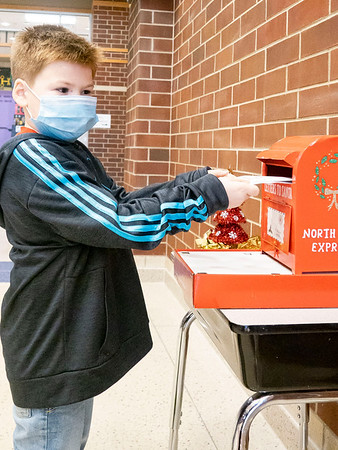Carson Martinez, 5, son of Andrea and Ricardo Martinez drops her letter into Santa's mailbox at Prairie View Elementary School. Carson attends Prairie View Elementary.
