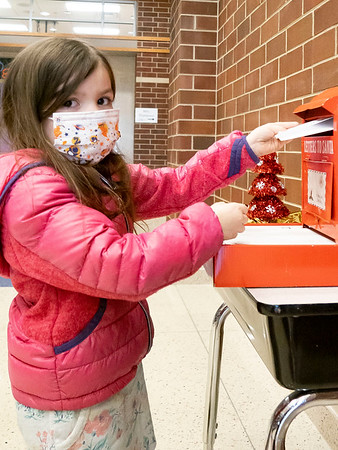 Lucy Martinez, 4, daughter of Andrea and Ricardo Martinez, drops her letter into Santa's mailbox at Prairie View Elementary School. Lucy attends Parkside Elementary in Goshen.