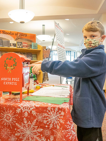 Ryne Leaman, 7, son of Jared and Addie Leaman, drops his letter into Santa's mailbox at the Goshen Public Library. Ryne attends Model Elementary.