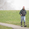 Stephen Cochrane, of New Paris, walks towards the Goshen Dam along the Goshen Dam Pond Trail on a snowy Wednesday afternoon to go fishing. The high reached in the upper 30's as of 3:30 p.m. according a national weather representative.