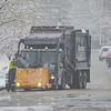 A Borden garbage truck driver performs his duty removing trash from a resident home along East Garfield Avenue in Goshen on a snow filled Friday afternoon.