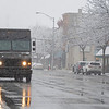 Snow returns to Goshen Friday morning. A UPS delivery truck drives down Main Street towards the intersection of Main Street and West Washington Street looking North.