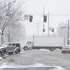 A truck passes through the intersection of West Washington Street and Third Street in Goshen on a snowy Friday afternoon.