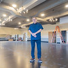Goshen Theater, Inc. President Everett Thomas, speaks about the details of the newly renovated Ball Room on the third floor of the Goshen Theater Wednesday afternoon. Renovations to the ball room include removal of the drop ceiling, a new floor, and new lighting.