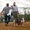 Bryce Resler receives a fist bump from Swine Judge Cory Edge Friday during the 2020 4-H Showcase at the Elkhart County 4-H Fairgrounds in Goshen.