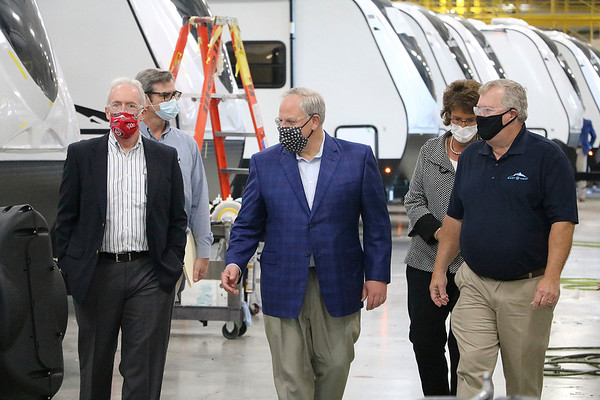 U.S. Interior Secretary David Bernhardt (center) tours the floor of a plant at East to West RV, 3000 C.R. 6, in Elkhkart Wednesday. Walking with him are Jay Landers, vice president of government affairs at the RV Industry Association (left), Eric Sharp, co-general manager of East to West (right) and Indiana Rep. Jackie Walorski (behind Sharp). The visit was part of an event where the heads of East to West and parent company Forest River Inc. signed Pres. Trump's Pledge to America's Workers.