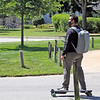 Roger Schneider | The Goshen News<br /> David Aguilar of Goshen, a senior at Goshen College, uses his electric-powered longboard to zip down a campus road Thursday afternoon. Goshen College began classes Tuesday amid the COVID-19 pandemic. Information from GC shows one student tested positive for the virus on Tuesday and has been quarantined.