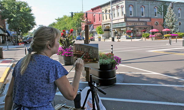 Roger Schneider | The Goshen News<br /> Nora Sallows of Indianapolis spent Friday morning painting an image of the historic Newell's building at the intersection of Main and Washington streets in Goshen. Sallows said she belongs to the Indiana Plein Air Painters Association and members often gather together to paint. She said the COVID-19 pandemic has caused members to persue their painting projects on their own.