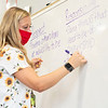 Chandler Elementary Fifth Grade High Ability Teacher Annie Jondle writes student responses on the dry erase board Monday morning at Chandler Elementary in Goshen. Monday was the first day of in person classes for Goshen Community Schools.