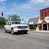 Joseph Weiser | The Goshen News <br /> A truck passes in front of the Middlebury General Store Monday afternoon along Main Street.