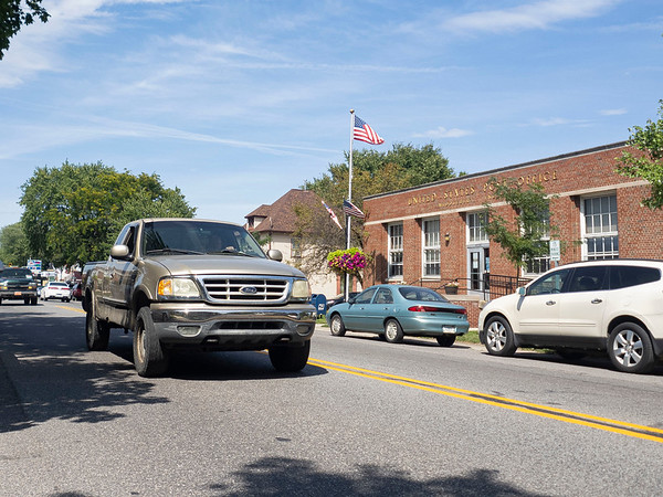 Joseph Weiser   The Goshen News <br /> A truck passes in front of the Middlebury Post Office Monday afternoon along Main Street.